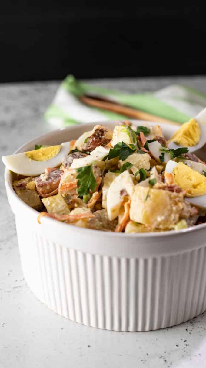 Potato salad in white bowl.