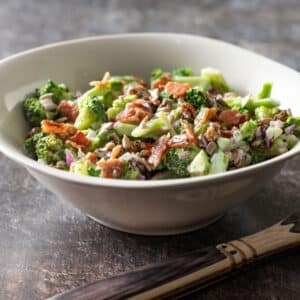 White bowl filled with broccoli salad.