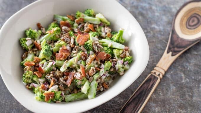 Horizontal photo of broccoli salad with custom spoon.