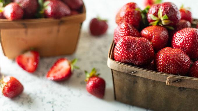 Side view of fresh strawberries in vintage baskets.