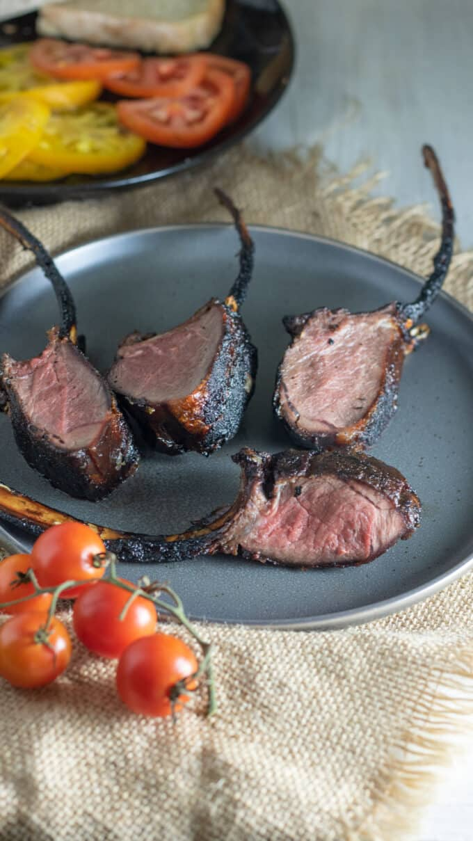 4 venison rib steaks on gray plate.