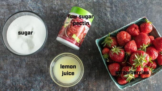Ingredients for jam strawberries, pectin, sugar, lemon juice.