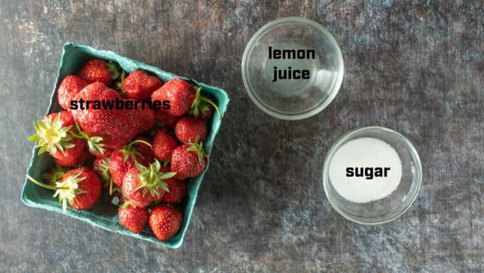 Ingredients for strawberry sauce. Strawberries, lemon juice, sugar.