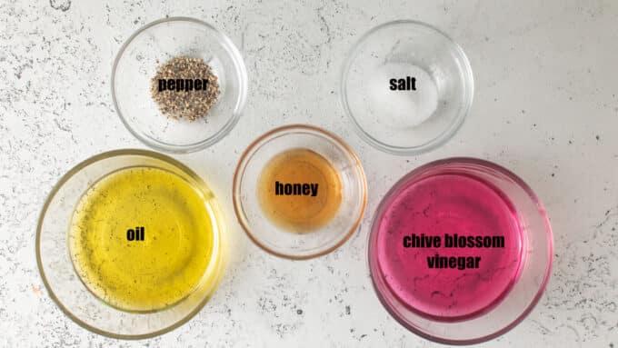 Ingredients for vinaigrette. Chive blossom vinegar, oil, honey, salt, pepper.