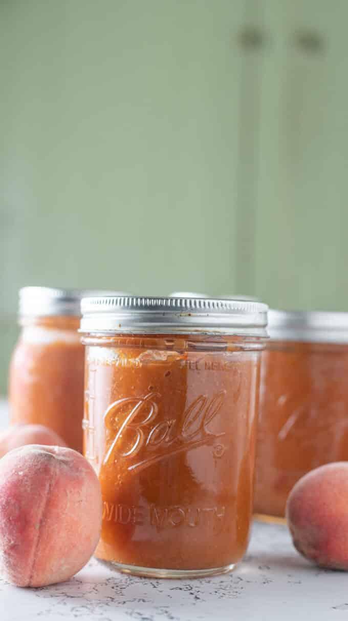 Jars of peach bourbon BBQ sauce.