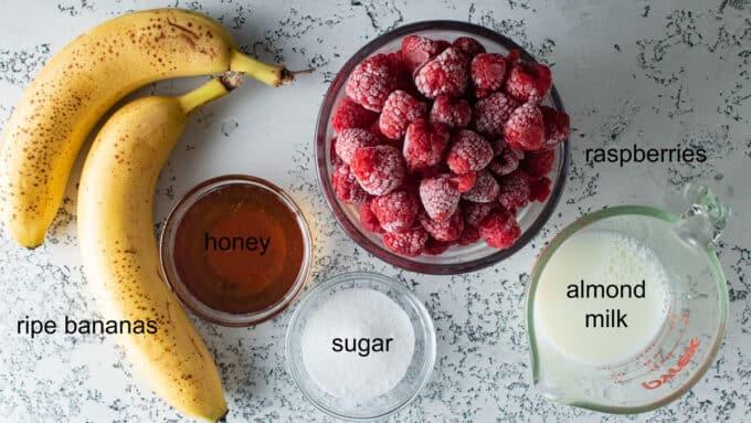 Ingredients for sherbet- bananas, raspberries, honey, sugar, almond milk.