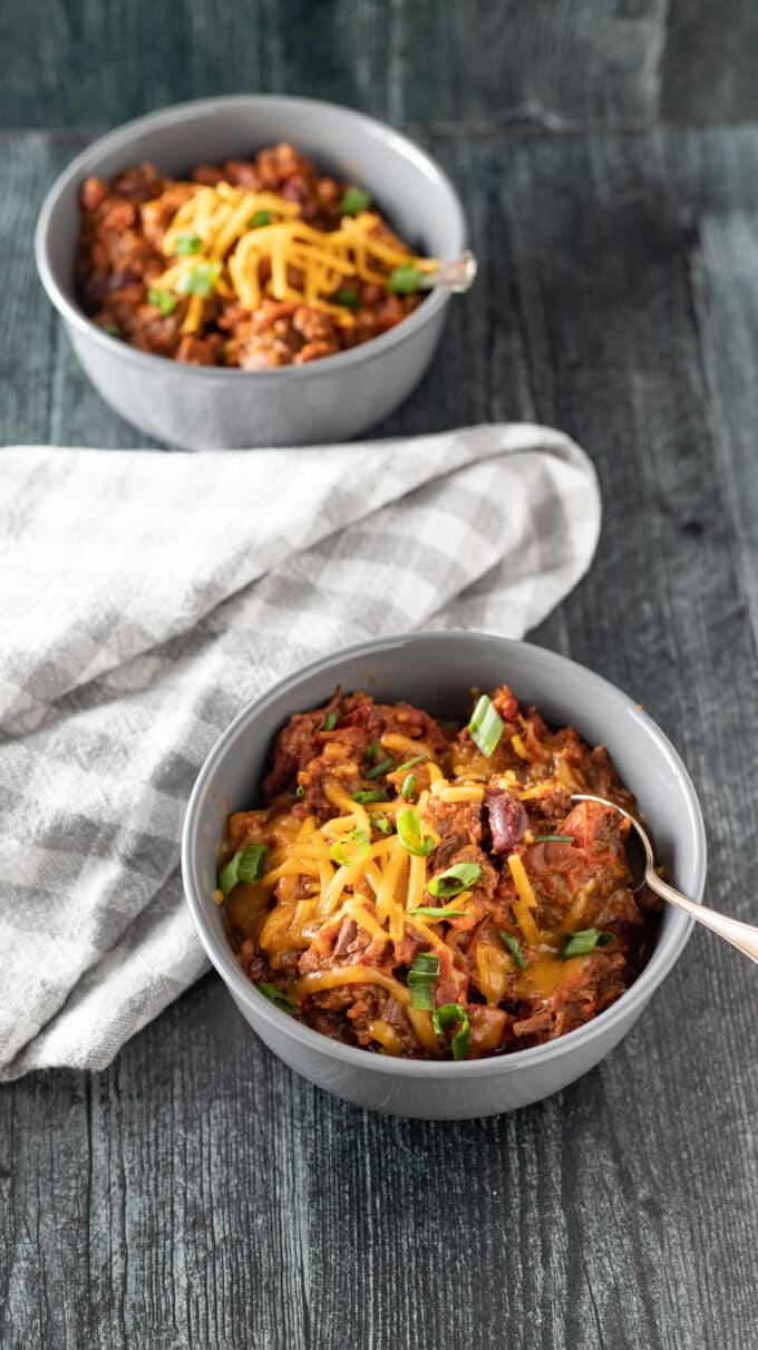 Chili with cheese and scallions.